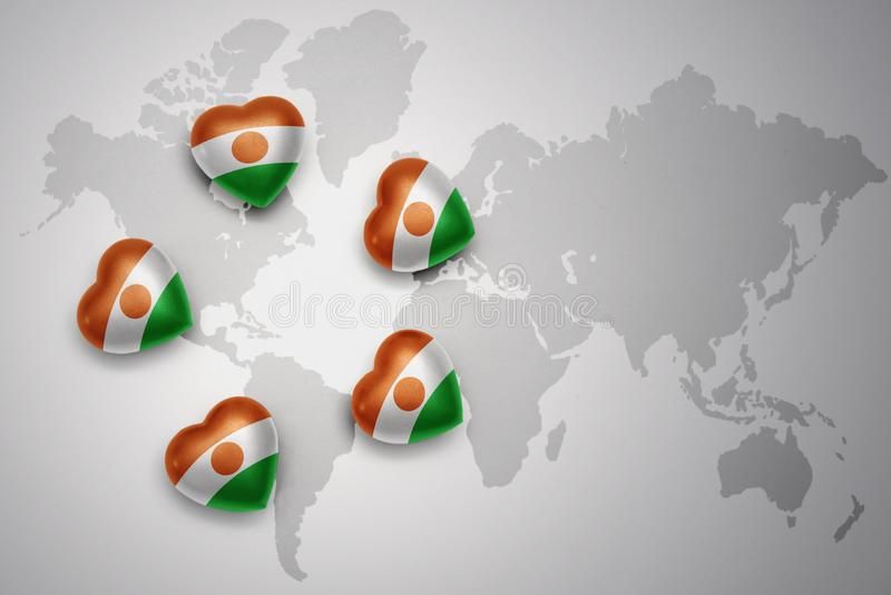 Five hearts with national flag of niger on a world map background. vector illustration