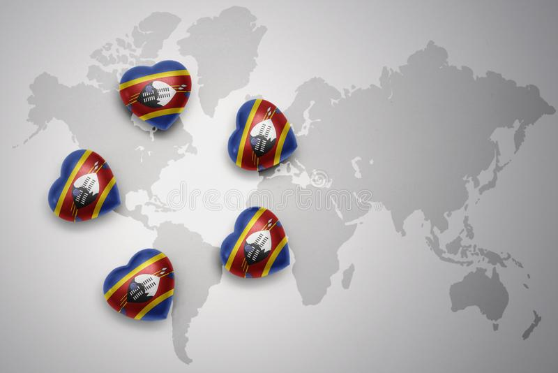 Five hearts with national flag of swaziland on a world map background. vector illustration