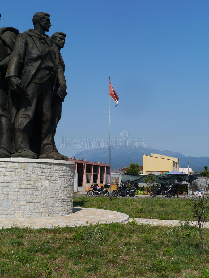 The Five Heroes of Vig monument, Albania. Albanian monument `The Five Heroes of Vig` in Shkodra with 3 motorcycles stock image