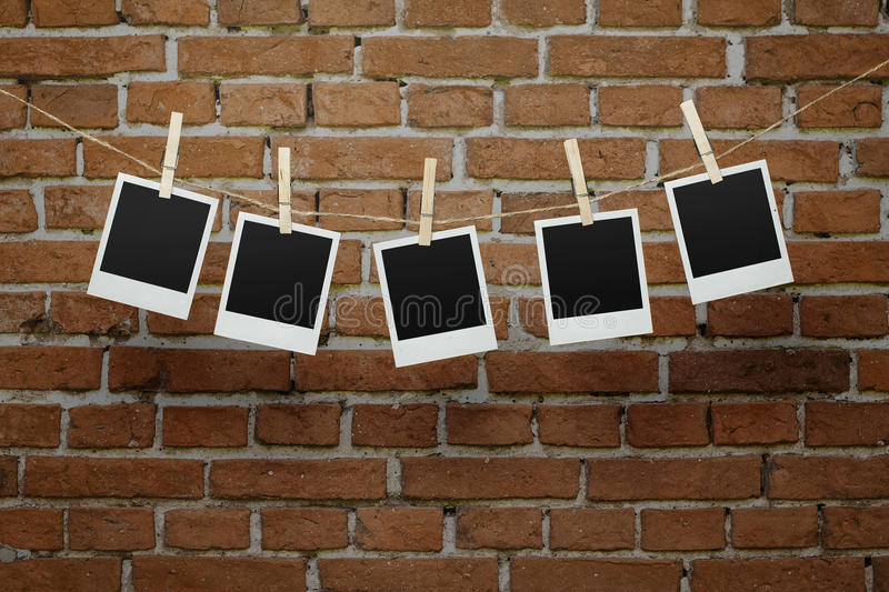 Download Blank Photos Over Brick Wall Stock Image - Image: 29971703