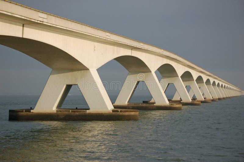 Five kilometers long bridge. 5 kilometers long bridge the zeelandbrug over nature reserve the oosterschelde in the netherlands, connecting two islands stock image