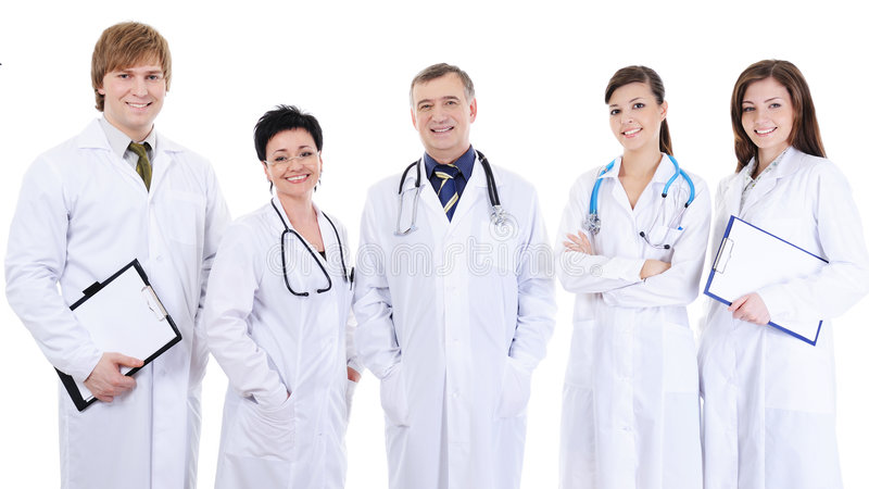 Five laughing successful doctors standing together