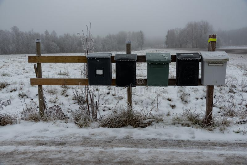 Five mail boxes standing outdoor in winter royalty free stock photo