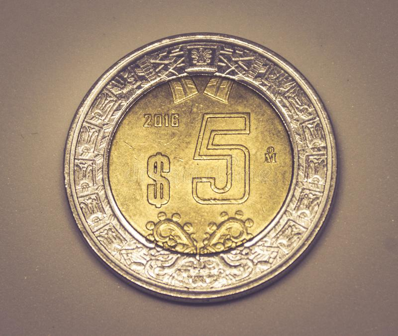 Five mexican pesos coin. MONTERREY, NUEVO LEON / MEXICO – FEBRUARY 20 2018: Close up photograph of five mexican pesos metal coin royalty free stock image