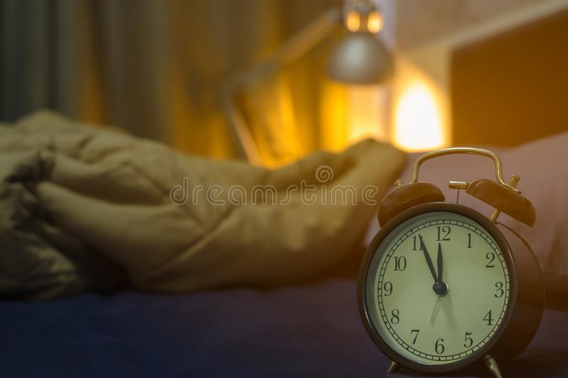 Five minutes before midnight. Close-up of Retro alarm black clock vintage style stock image