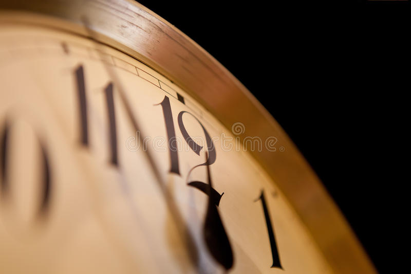 Five minutes to twelve. On old clock royalty free stock photography