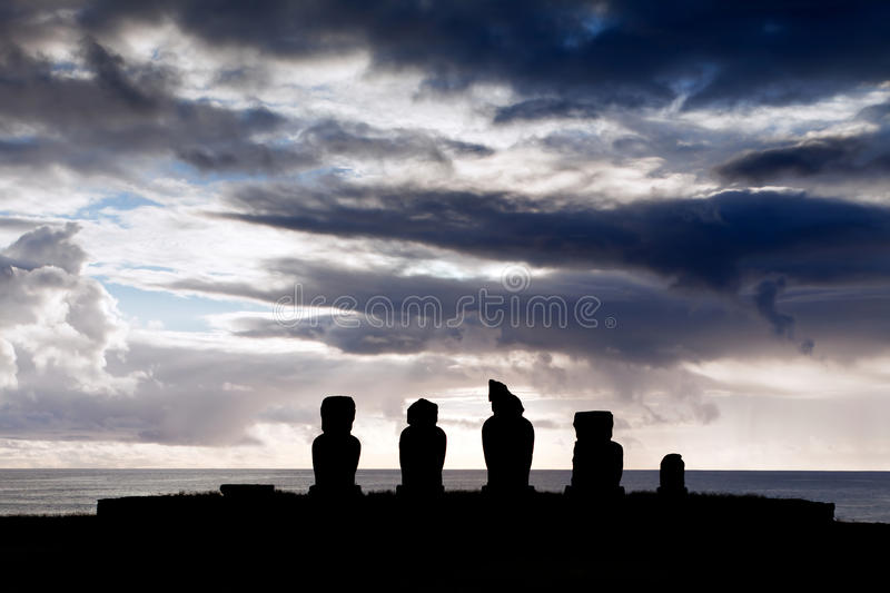 Five moai in silhouette in Easter Island stock photography