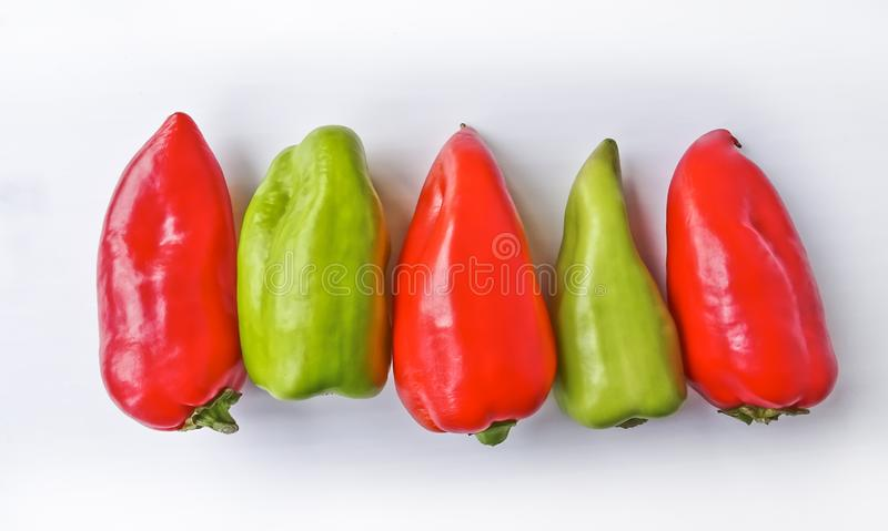 Five multicolored bell peppers isolated stock image