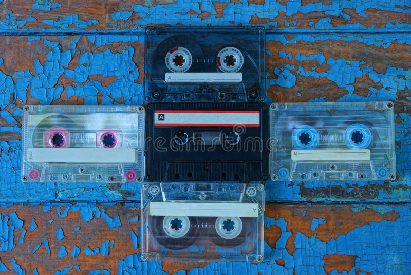 old audio tapes are on the blue board royalty free stock photos