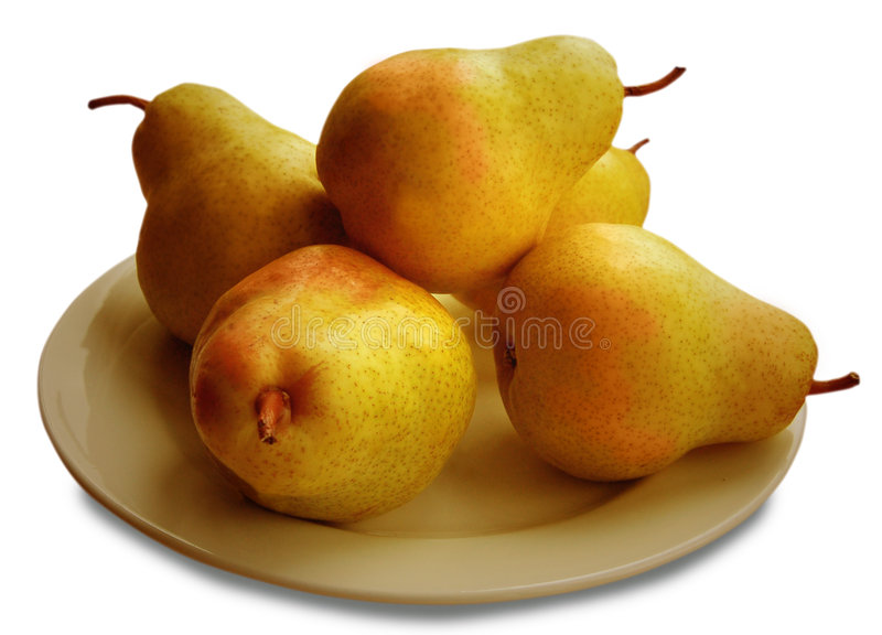 Five Pears. Five ripe pears arranged on a plate as an isolated still life stock image