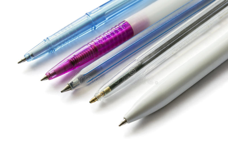 Five pens. Five different ballpoint pens isolated on white background stock images