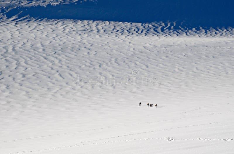 Five people trekking stock images