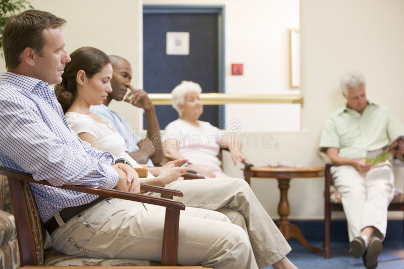 Five people waiting in waiting room stock photography