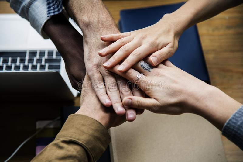 Five Person Holding Hands Together stock image