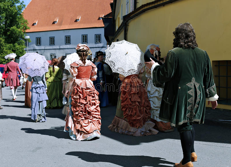Five-petalled Rose Festival on bystreet in Cesky Krumlov stock images