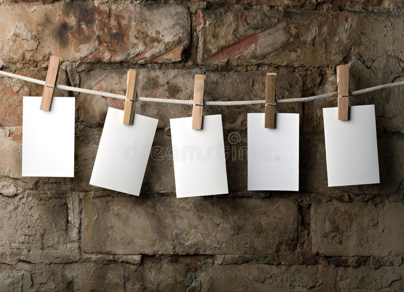 Five photo paper attach to rope with clothes pins royalty free stock image