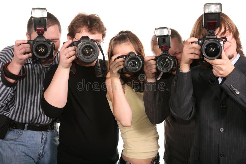 Five photographers 2 stock photo