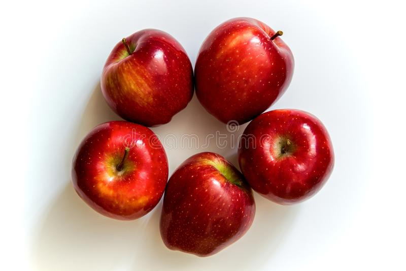 Five apples. Five red apples are on a white background, red apples folded into a circle stock photo