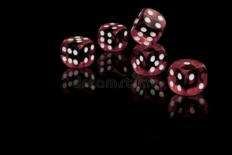 Five red dices on black background stock photos