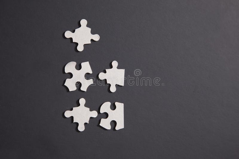 Five scattered puzzle pieces stock image
