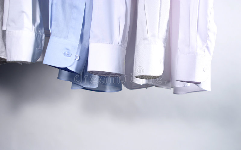 Five Shirts hanging stock images