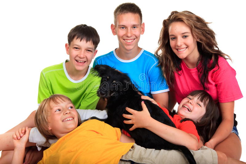 Five siblings with black dog stock photos