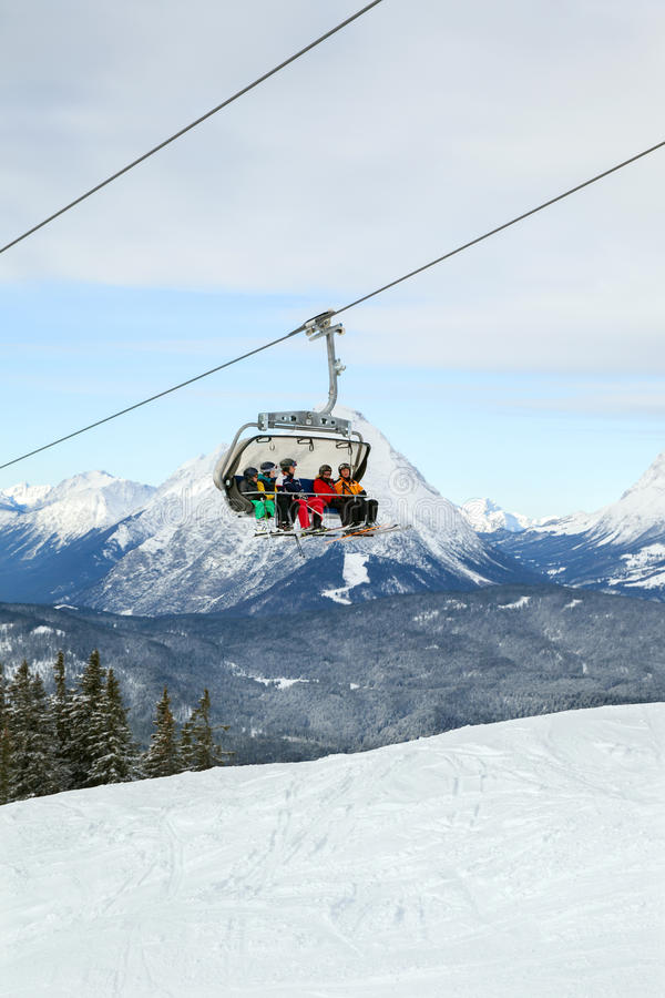 The five skiers are ascending by chair lift royalty free stock photo