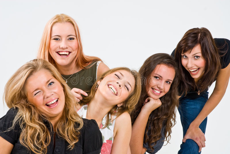 Five smiling women. A studio view of five pretty and very happy women, posing with bright, exuberant smiles stock image
