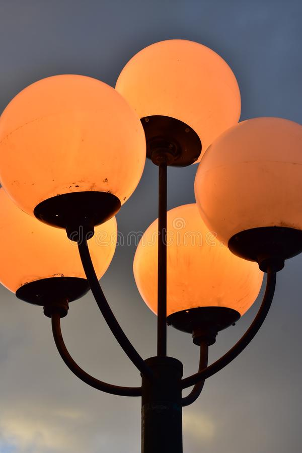 Five spherical lamps on post stock image