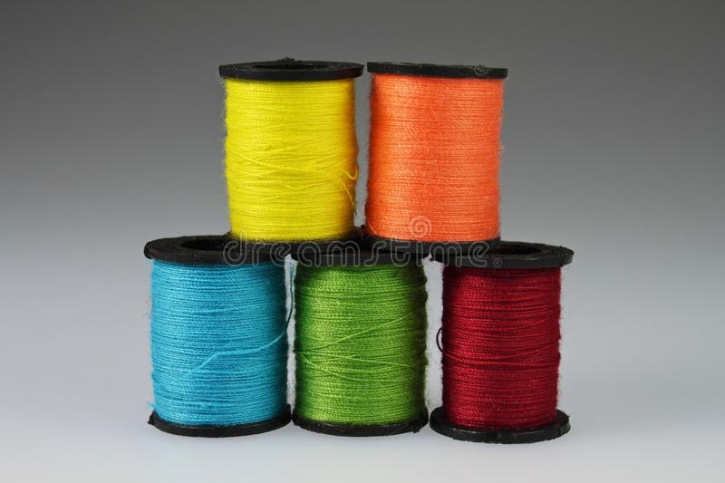 Five stacked Spools of Yarn