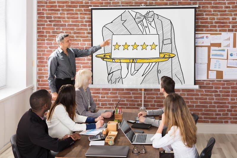 Five Star Hospitality Service Presentation. Team At Five Star Hospitality Service Presentation In Office royalty free stock photography