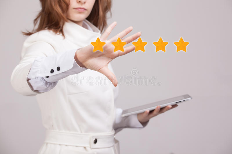 Five star rating or ranking, benchmarking concept. Woman assesses service, hotel, restaurant royalty free stock images