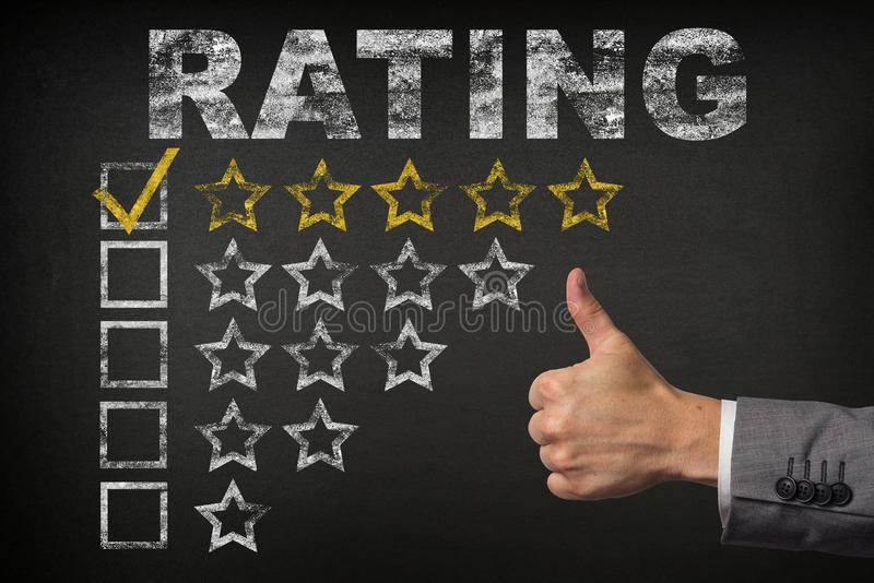Five 5 Star Rating. thumbs up service golden rating stars on chalkboard royalty free stock images