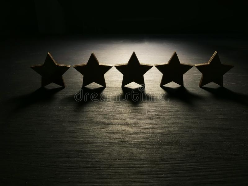 Five stars in the dark. Customer experience and satisfaction royalty free stock image