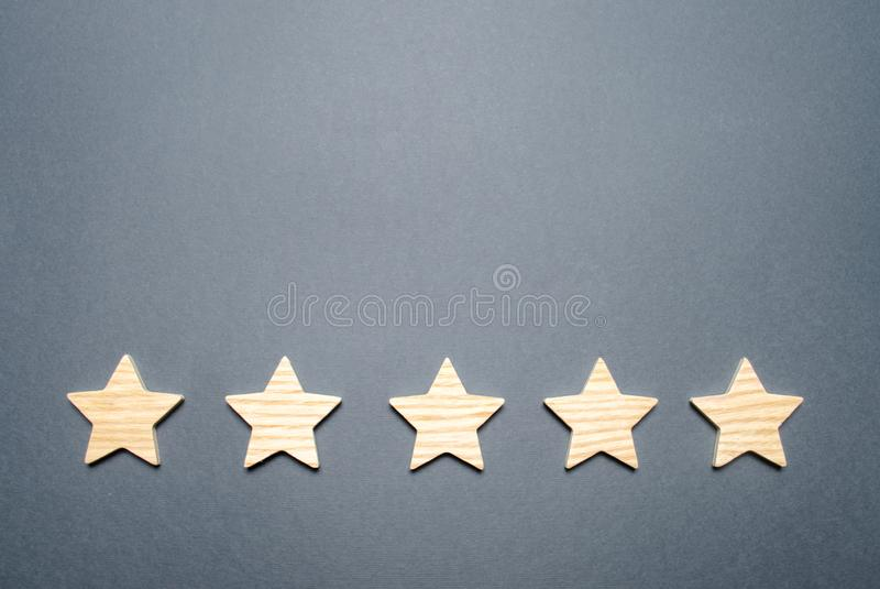 Five stars on a gray background. Rating and status of the restaurant or hotel. Prestige and a good title. High quality. And reliability, universal acceptance stock images