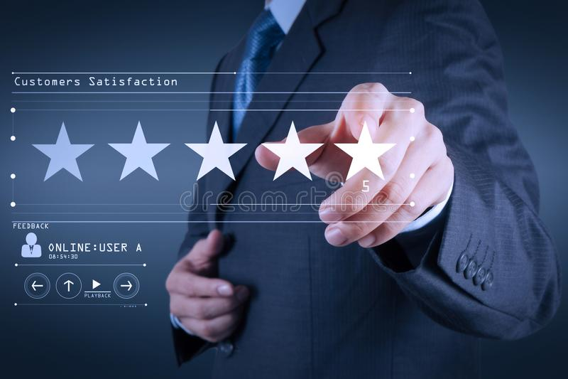 Five stars 5 rating with a businessman is touching virtual computer screen.For positive customer feedback and review with excell stock photo