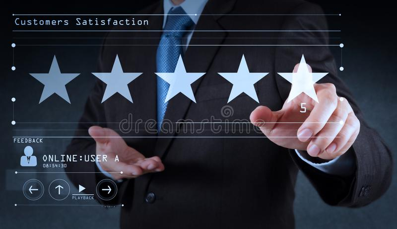 Five stars 5 rating with a businessman is touching virtual computer screen.For positive customer stock photos