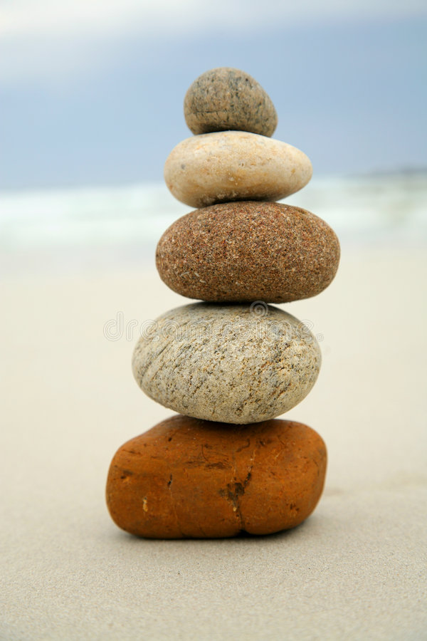 Five stones balanced on top of each other. On a beach royalty free stock images