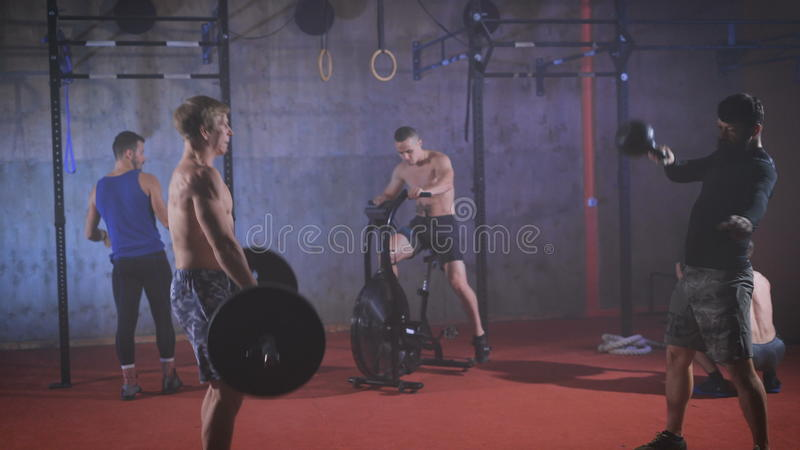 Five Strong Athletes Doing Group Crossfit Training At The Gym Stock Video