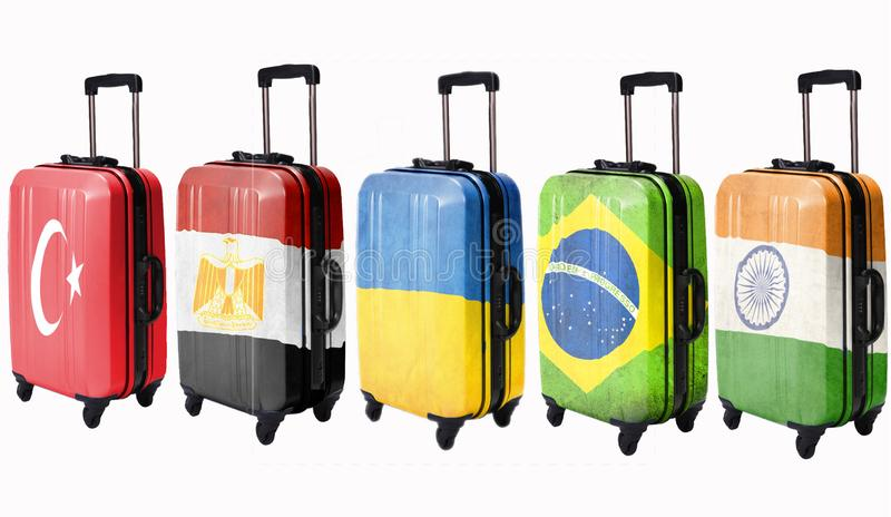 Five suitcases with flags depicted on these countries: Egypt, Ukraine, Brazil, Turkey, India. Isolate. Five suitcases with flags depicted on these countries royalty free stock images