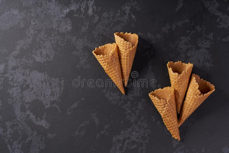 Five sweet wafer cones on a black background. Top view ice cream scoops summer waffle dessert delicious cold flavor tasty fresh sundae frozen snack dairy stock photos