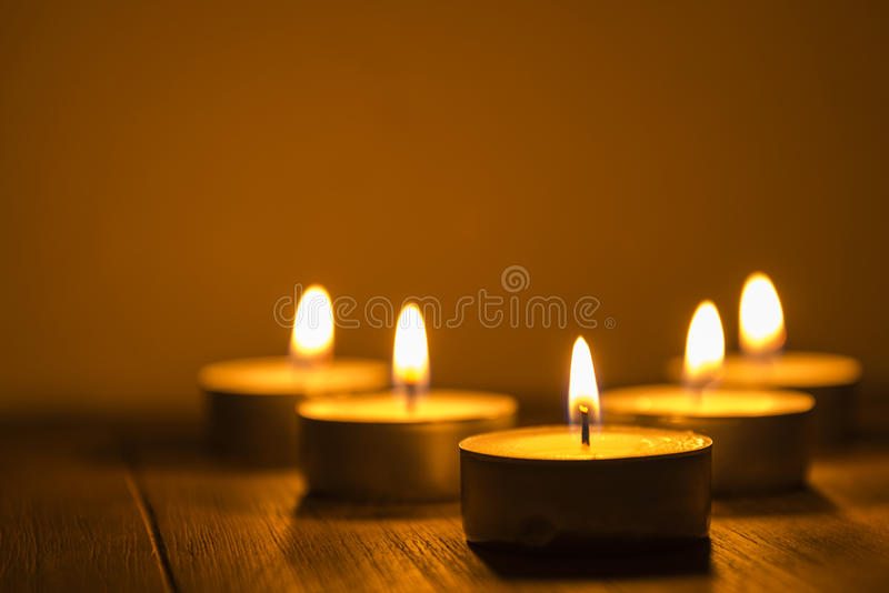 Five tea lights. On a table, shallow depth of field royalty free stock photos