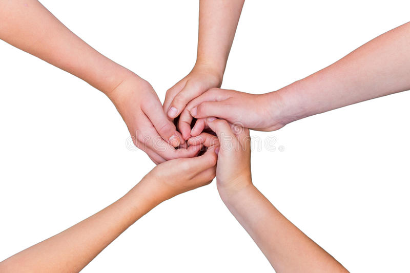 Five teenage arms with hands entangled isolated on white background stock photography
