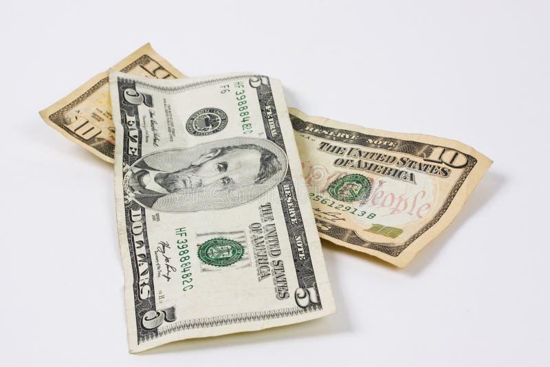Five and Ten dollars bills stock images