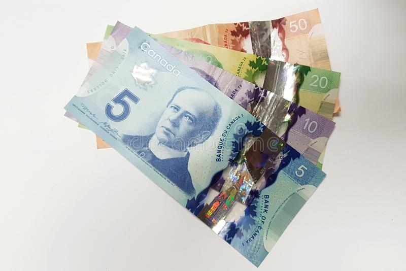 Colorful Canadian paper bill money layered on top of each other stock photos