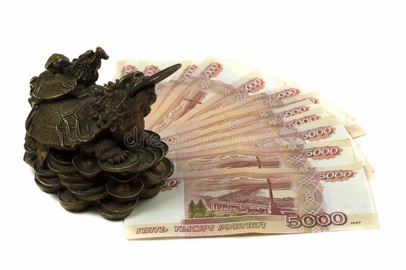 Five thousandth Russian rubles with a dragon figurine. A simfol of monetary well-being with large banknotes stock image