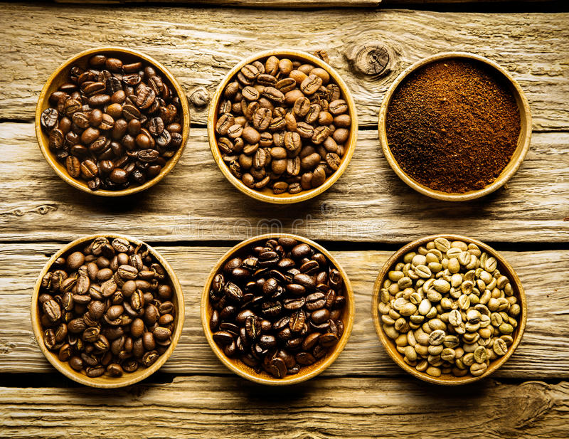 Five varieties of coffee beans and powder royalty free stock photos
