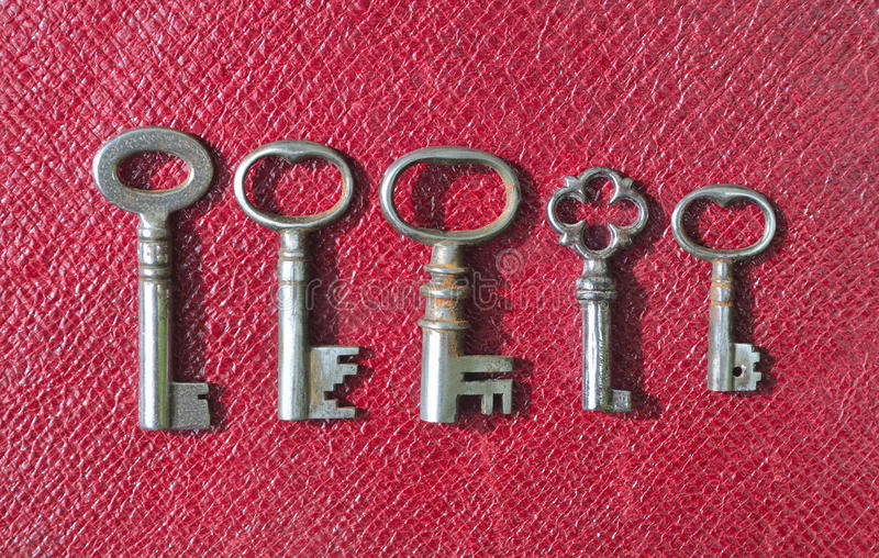 Five very small Antique pipe Keys stock photography