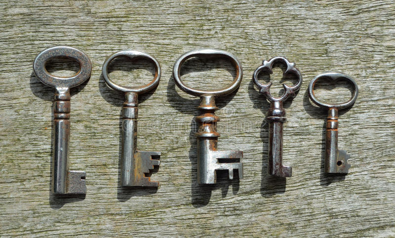 Five very small Antique pipe Keys royalty free stock images