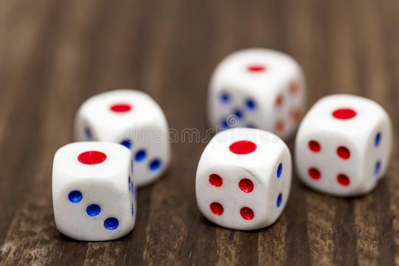 Five white dice shows the number 1 on a wooden table. Five white dice showing one royalty free stock photography